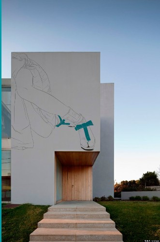 Artist Virtually 'Paints' Ancient Drawings Onto Modern Homes Around The World