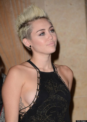 Miley Cyrus' TMI Moments: From Sideboob To Twitter Pics And Everything In Between (PHOTOS)