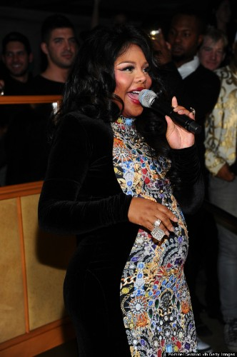 Lil Kim Pregnant With Her First Child, Debuts Baby Bump At NYFW