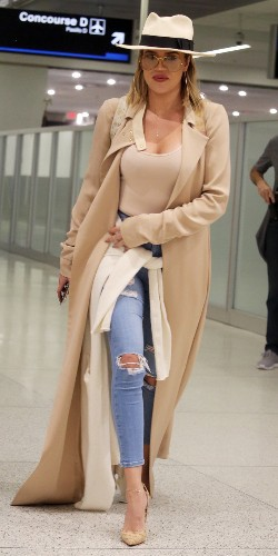 Khloé Kardashian and Her Nude Bodysuit Turn Heads at the Airport