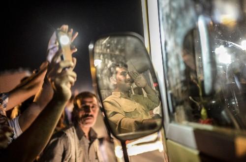 Iraqi Kurdish forces enter besieged Kobani to battle Islamic State