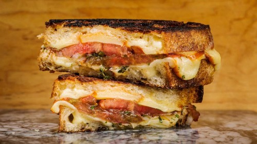 Get ready for your new favorite sandwich: Grilled cheese with marinated tomatoes