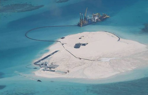 China expands islands on disputed reefs in South China Sea