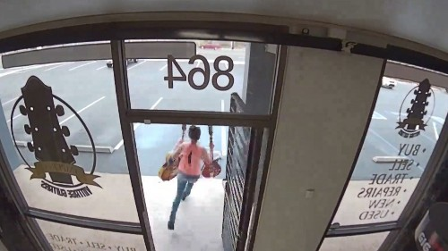 Video shows woman stealing two $10,000 vintage guitars from O.C. store