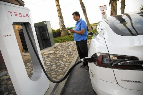 Why the Tesla and electric car boom could be good news for the grid