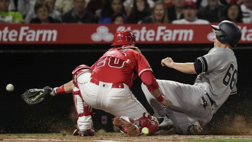 Angels let 14-inning game slip away in loss to Yankees
