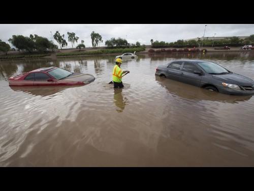 Woman dies in submerged car in record Arizona rain, widespread floods