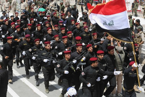 Sadr followers march in Iraq as Sunni militants capture two towns