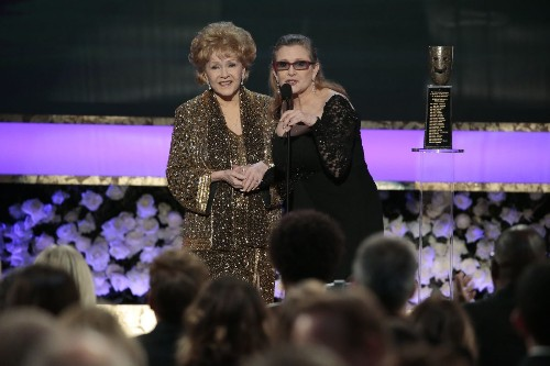 Debbie Reynolds dies at 84, a day after her daughter Carrie Fisher's death