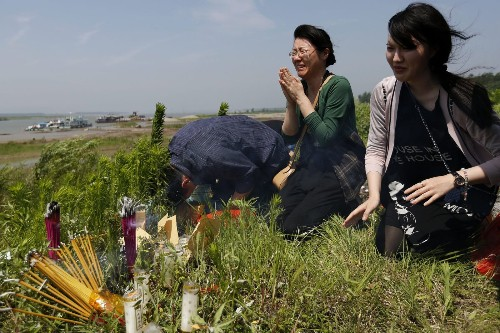 Rescuers describe gruesome recovery of Chinese ship victims