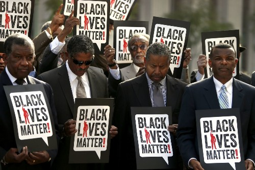 Black men in business suits protest alleged police misconduct - Los Angeles Times