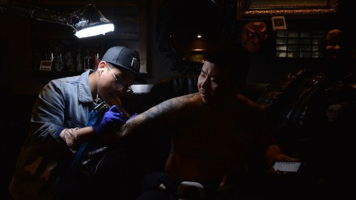 He was a school dropout with an uncertain future. But tattoos changed everything