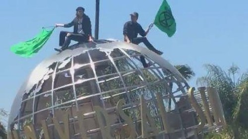 4 are arrested after protesters scale Universal Studios globe in Earth Day demonstration