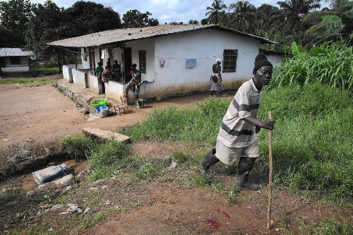Texas Ebola patient aided Liberia woman thought to have malaria