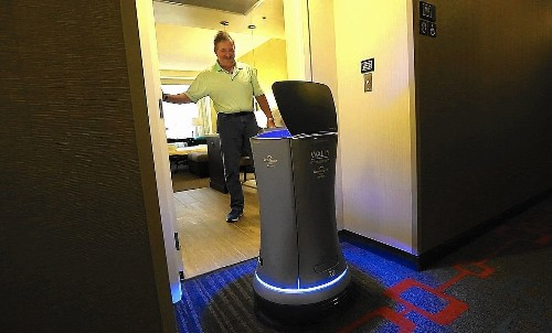 Robots deliver fun with hotel room service orders, and they don't expect a tip - Los Angeles Times