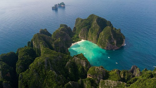 Explore the emerald waters of Thailand's Phuket Island by private yacht