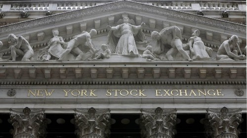 Stocks waver as traders sift through company earnings