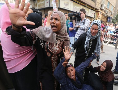 Egyptian court sentences 683, including Brotherhood leader, to death