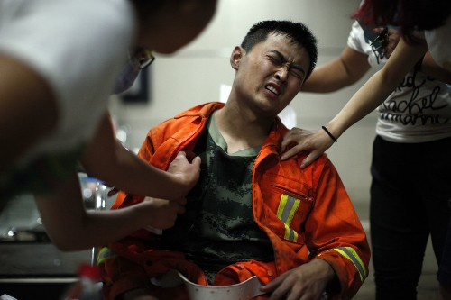 Chinese firefighters paid high price in blasts that water may have triggered