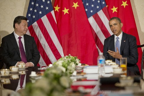 Obama defends NSA spying in meeting with Chinese president
