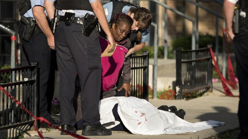 Mother pleads with police at fatal Chicago shooting: 'I need to touch my son'
