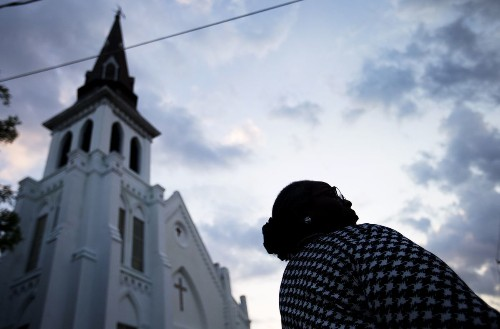 Obama embraces race, religion in moving address at Charleston funeral
