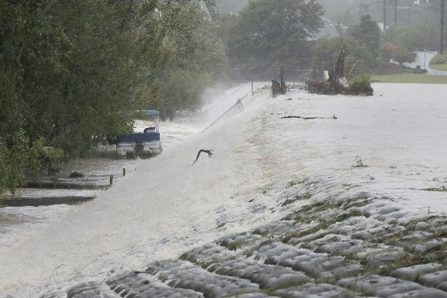 South Carolina residents rush to higher ground as 14 dams fail