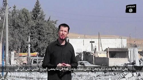 Hostage 'news report' video says Islamic State close to taking Kobani