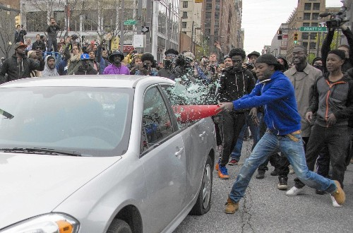 Scattered violence in Baltimore protests of man's death after police custody