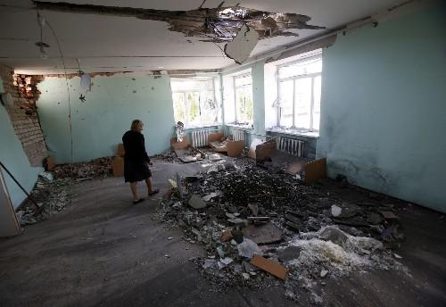 Ukraine cease-fire in peril; Merkel urges Putin to respect it - Los Angeles Times
