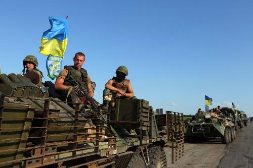 Separatist rocket attacks, bus ambush kill 30 in eastern Ukraine
