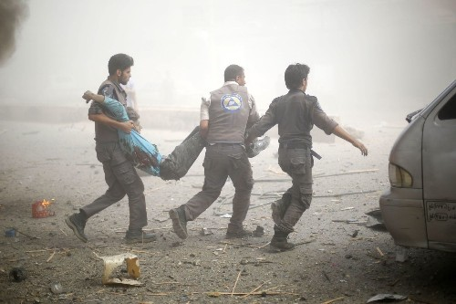 Air attack hits crowded market in Syria; more than 80 dead, watchdog says