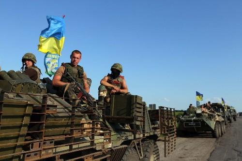 In eastern Ukraine, separatist rocket attacks, bus ambush kill 30