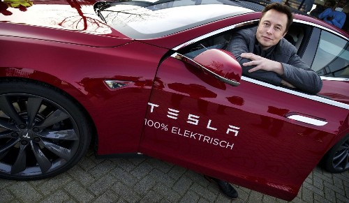 Tesla Motors closes at record after Apple merger rumor surfaces