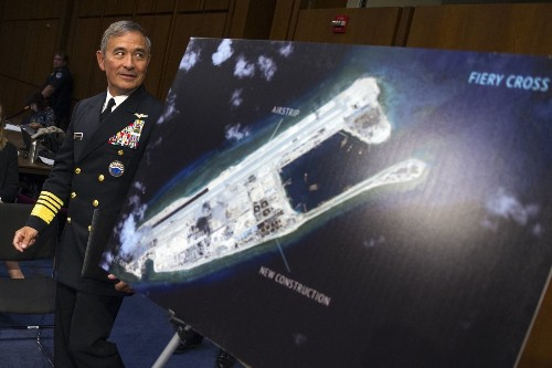 China, angered over warship patrol near artificial islands, warns U.S. not to 'create trouble'