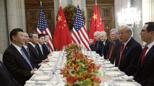 Stocks finish mixed ahead of U.S.-China trade talks