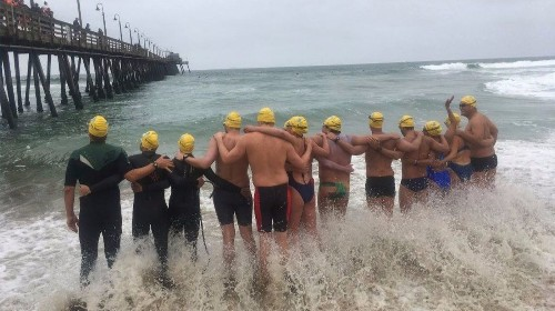Athletes swim across U.S.-Mexico border in immigrant-rights protest