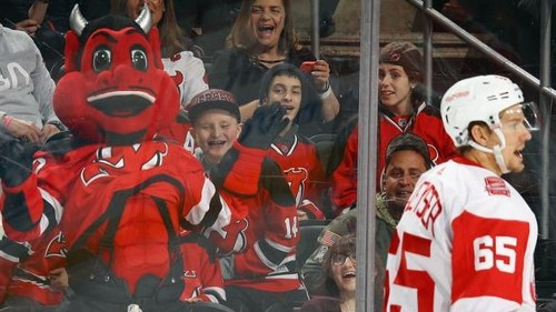 New Jersey Devils mascot shatters a giant window at a child's birthday party