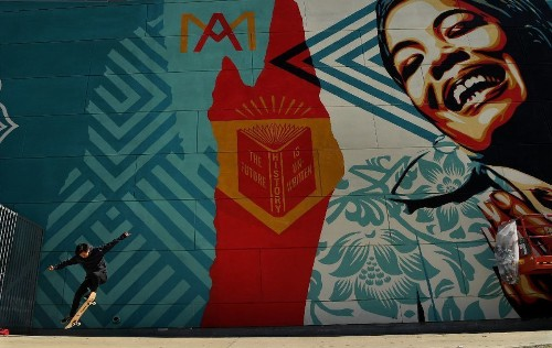 Shepard Fairey and 30 other artists turn Maya Angelou school into an outdoor gallery