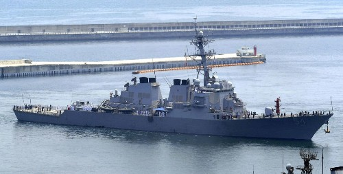 Beijing says U.S. warship 'sabotaged the peace' by sailing near island in South China Sea