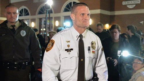 In Ferguson, 'Officer Friendly' tries to ease tension on both sides