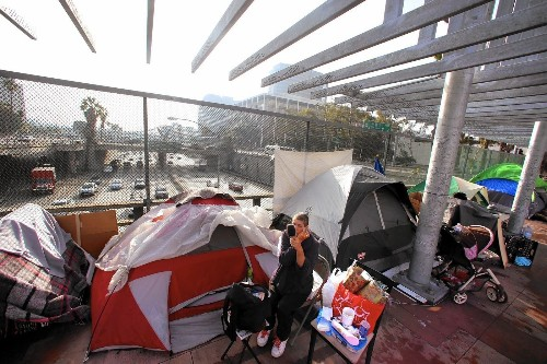 What those homeless camps along L.A.'s freeways mean for a public space once above it all