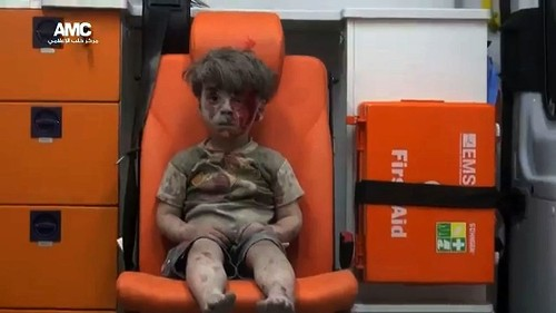 Haunting image of boy in an Aleppo ambulance captures plight of children caught in Syrian war - Los Angeles Times