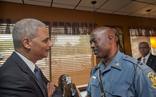 Holder distances federal probe from local investigation in Ferguson - Los Angeles Times