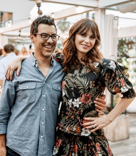 Here's one way to make people care: Host an entertaining but informative dinner party with Zooey Deschanel