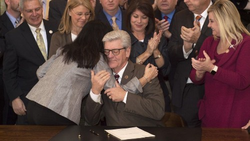 Mississippi governor signs law banning most abortions once a heartbeat can be detected