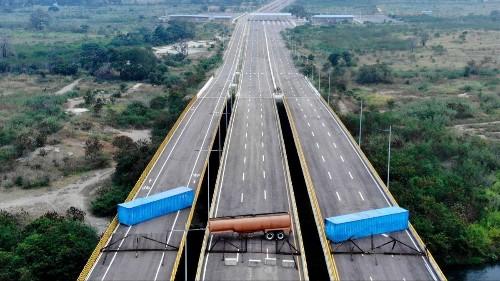 As Venezuela crisis deepens, troops block border to halt arrival of food and medicine