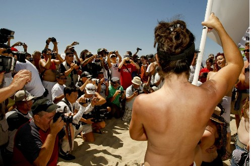 Venice prepares for annual topless parade and protest