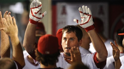 Angels clinch a playoff berth, but two injuries take the edge off