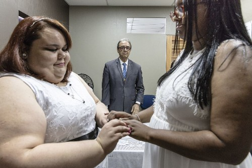 Fearful that the president will change the law, same-sex couples in Brazil rush to the altar
